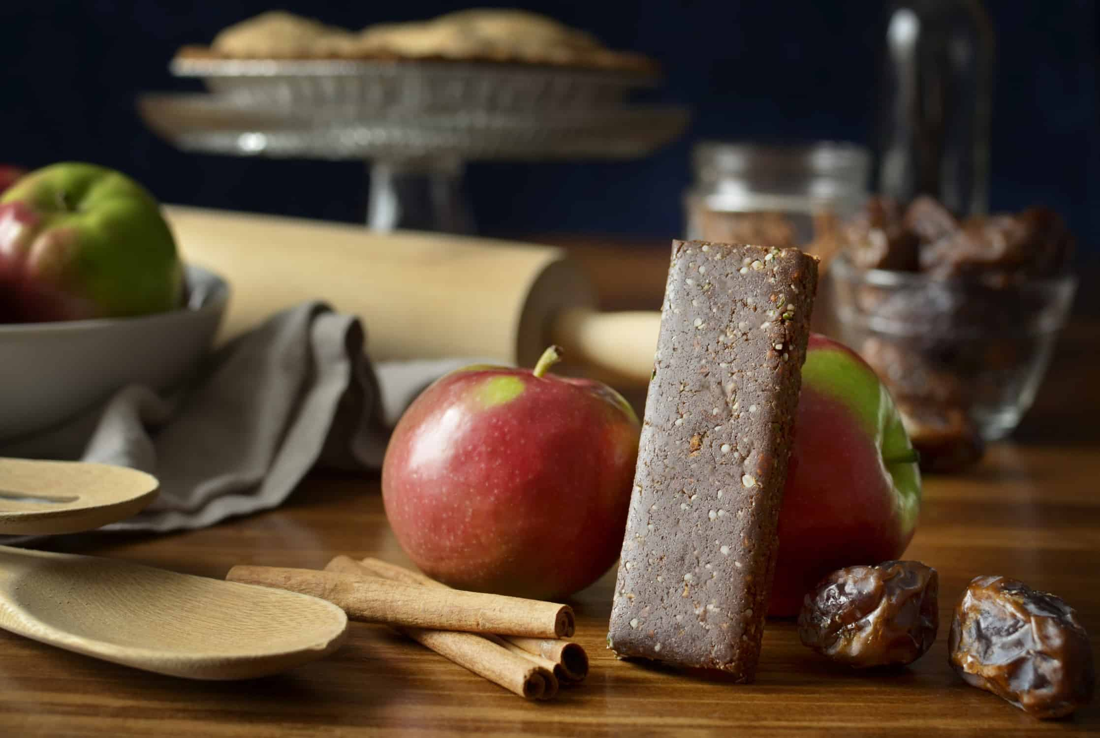 Fit Cricket Protein Bar leaning on an apple
